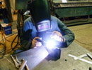 TIG welding a stainless component in our fabrication shop.